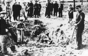 Laborers exhume the corpses of people shot during an action on 12 May 1942
